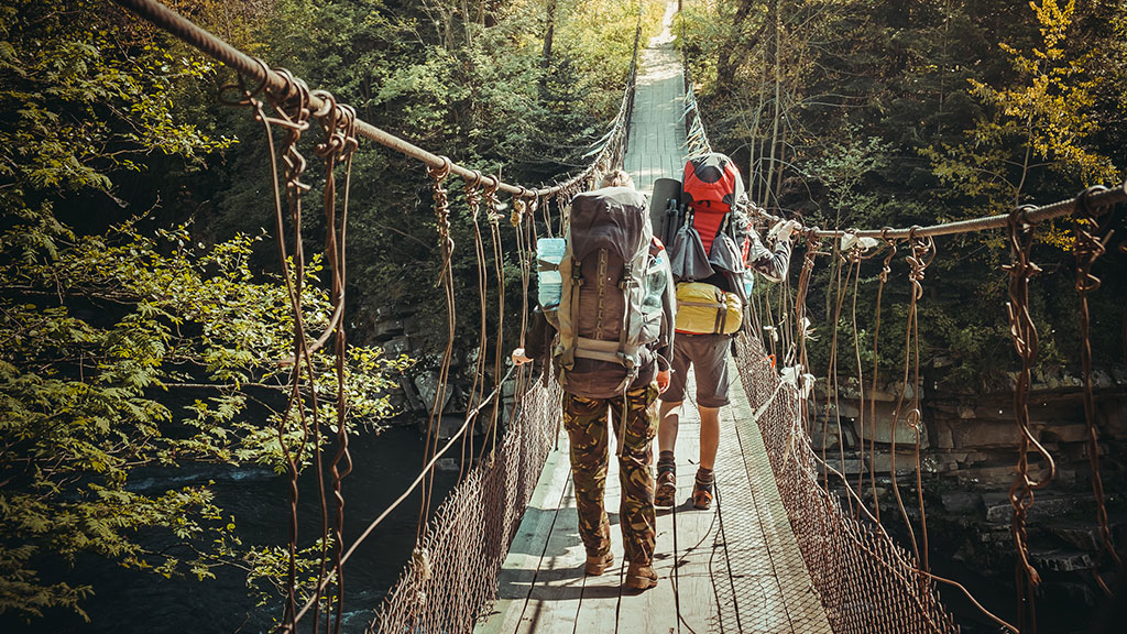 Travelers Crossing Through Hanging Bridge