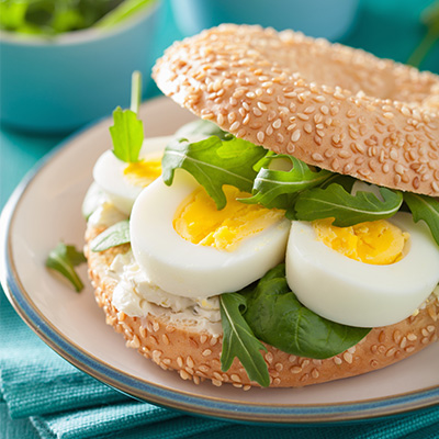 breakfast-sandwich-on-bagel-with-egg-cream-cheese